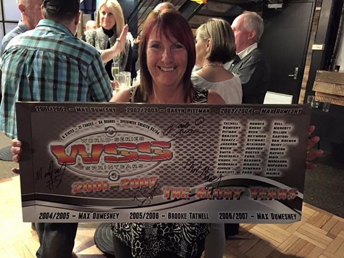 Mandy Searle showing the Autograph panel that was auctioned on the night