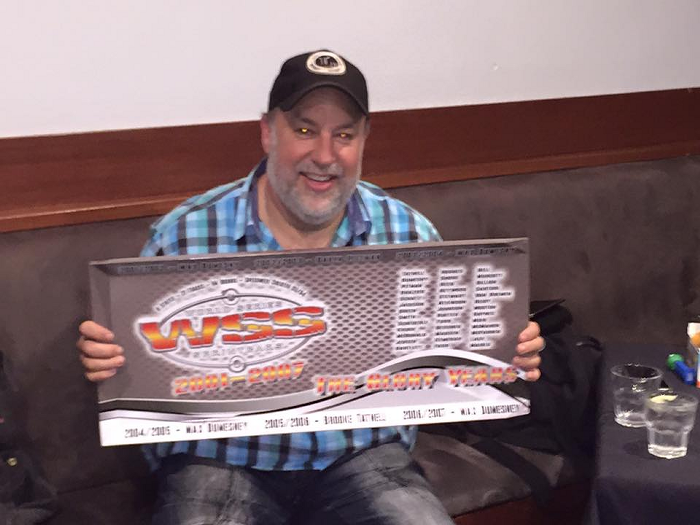 Wade Aunger holding the WSS Reunion Panel created by Gator Wings for the event